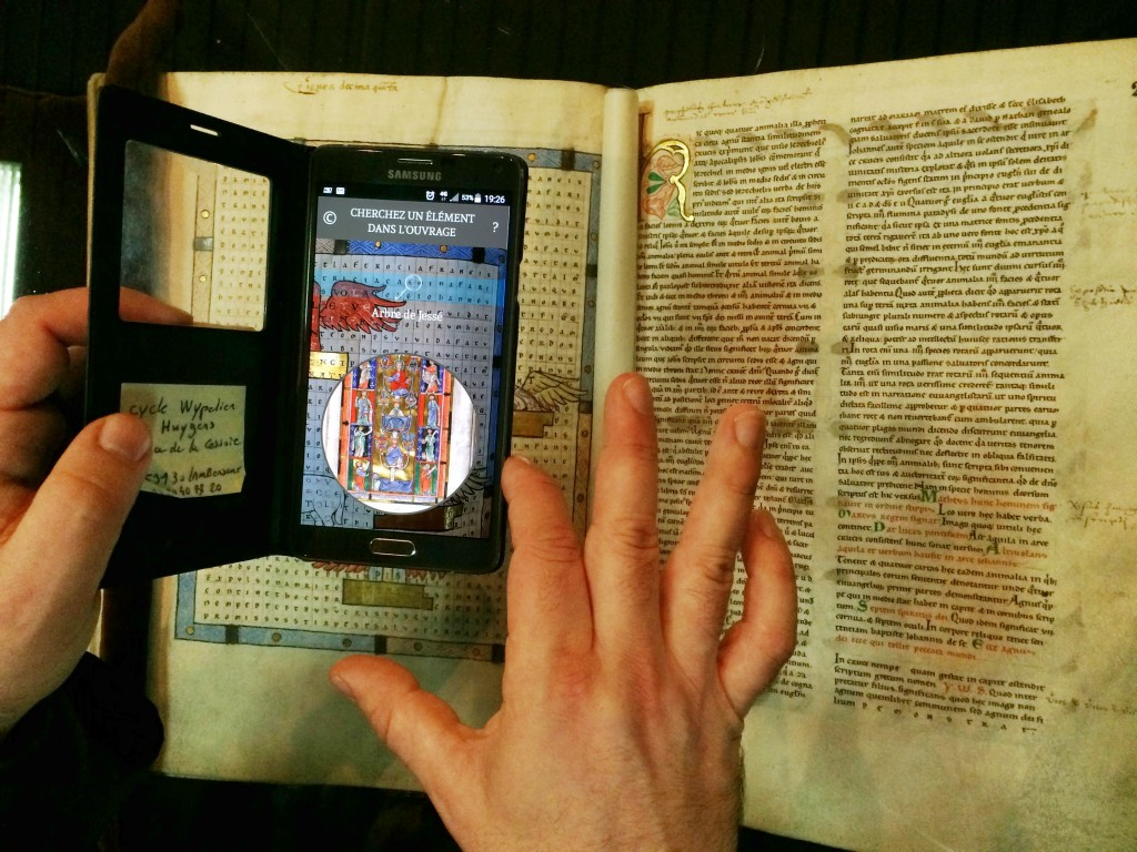 Ancient book, smartphone interaction, interactive display case